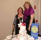 60th anniversary cake cutting with Teresa Lyford SISWP president