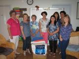 Donating sets of towels to Eastern Domestic Violence Service